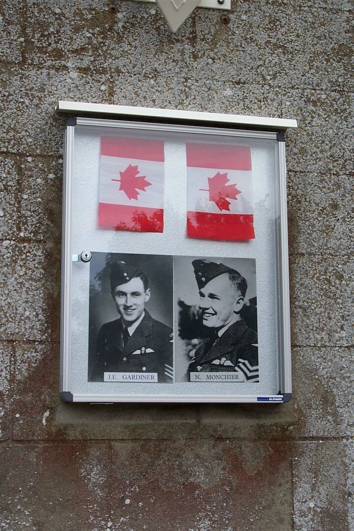 Photos of Pilot Officer Norman Monchier (right) and Pilot Officer John Gardiner are displayed on a wall of St. Aubin-le-Cauf churchyard, located about nine kilometres from Dieppe, France. PHOTO: Via Canadian Virtual War Memorial