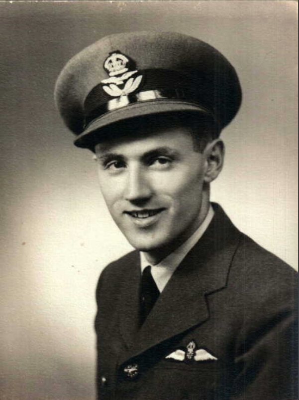 A vintage head-and-shoulders photograph of a young man wearing a military uniform, including tunic, tie and peaked hat. There are wings on the tunic near the lapel.