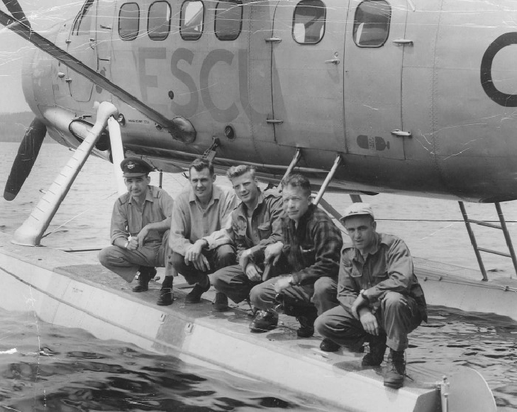 On July 14, 1958, four days after the discovery of the wreck of Delta 673, the RCAF sent a ground party to investigate; they flew from RCAF Station Greenwood, Nova Scotia, in a de Havilland Canada DHC-3 Otter from No. 103 Rescue Unit. From left are Flying Officer Pat Donaghy (pilot). Flying Officer M.G. Cloutier, Corporal J.R. Lemieux, Sergeant Robert Crebo and Corporal William Armstrong, photographed at Third Loch Lomond Lake, on July 16, 1958. PHOTO:  Courtesy of Pat Donaghy, RCAF retired