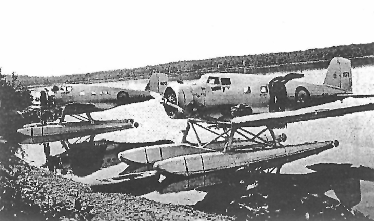 "In early September 1939, Northrop Delta 671 from 8 Squadron (foreground) arrives at Lac Mégantic, Quebec, from RCAF Station Rockcliffe, Ontario, with a new Wright Cyclone engine on board. In the background, Warrant Officer James Doan and Corporal David Rennie prepare 673 to receive the new engine. PHOTO: From ""Mystery Plane Found in New Brunswick"", by James Cougle"