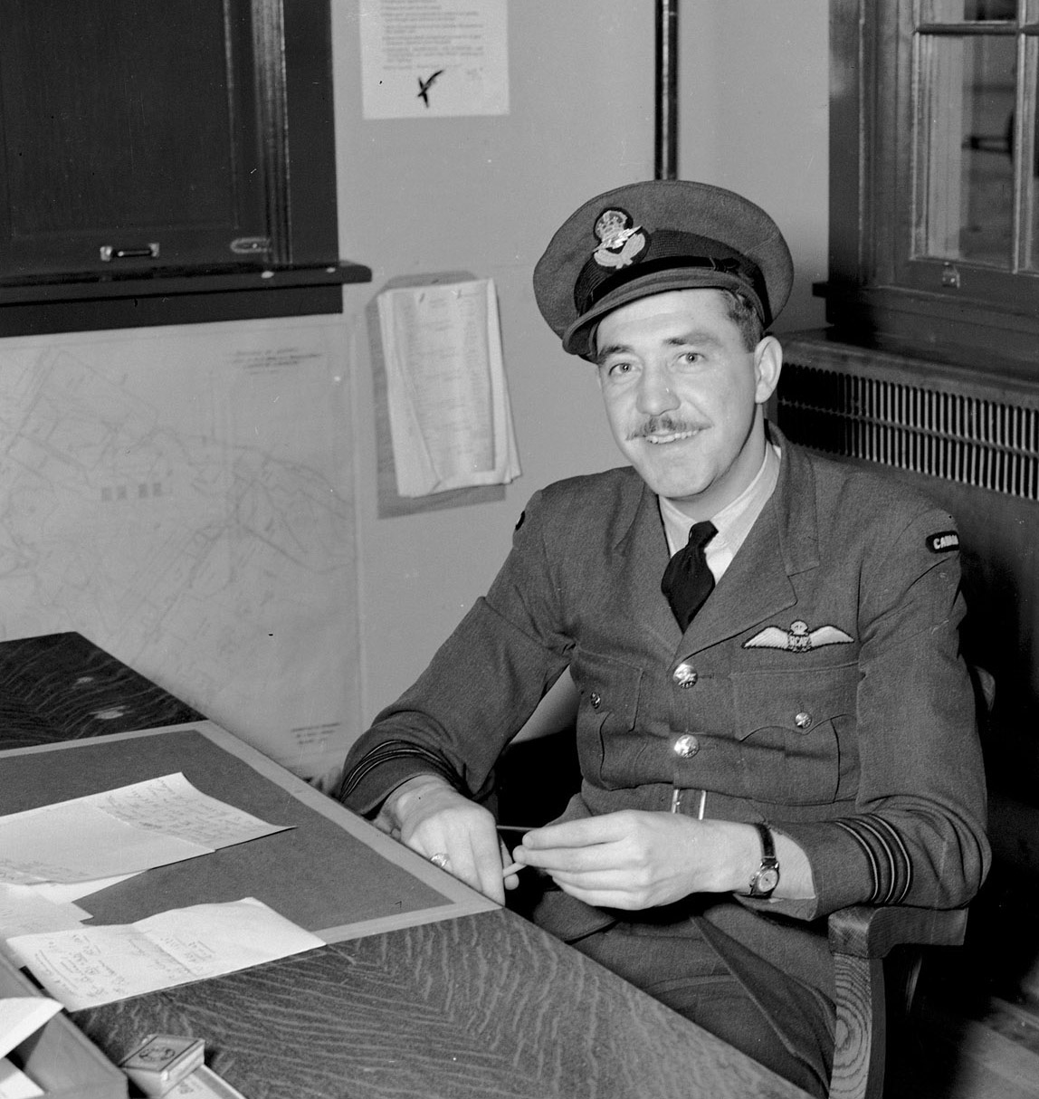Battle of Britain pilot Wing Commander Edwin Michael Reyno, photographed at No. 1 Operational Training Unit in Bagotville, Quebec, on November 30, 1942, while he was chief instructor. In 1941, Reyno took command of No. 115 Squadron, a fighter squadron established to protect Canada's west coast. PHOTO: DND Archives, PL-12672