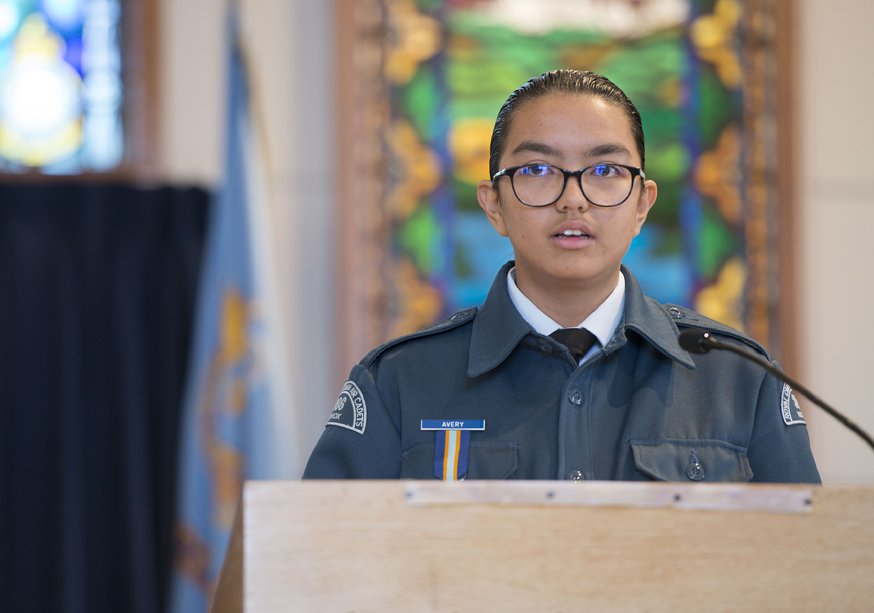 "Warrant Officer Second Class Gabby Avery, from 386 Komox Royal Canadian Air Cadet Squadron, reads the poem ""High Flight"" on September 15, 2019, during the 19 Wing Comox, British Columbia, Battle of Britain remembrance ceremony held in the wing chapel. PHOTO: Sergeant Andrew Davis, CX03-2019-0331-003"