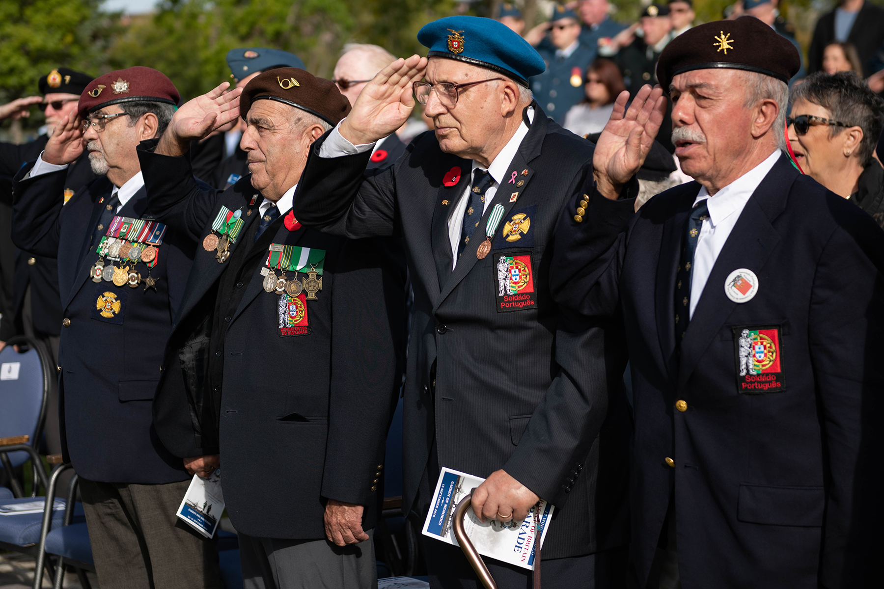 Portuguese-Canadian veterans salute during the September 15, 2019, ceremony held at 17 Wing Winnipeg, Manitoba, marking the 79th anniversary of the Battle of Britain. PHOTO: Corporal Angela Gore, WG2019-0456-002