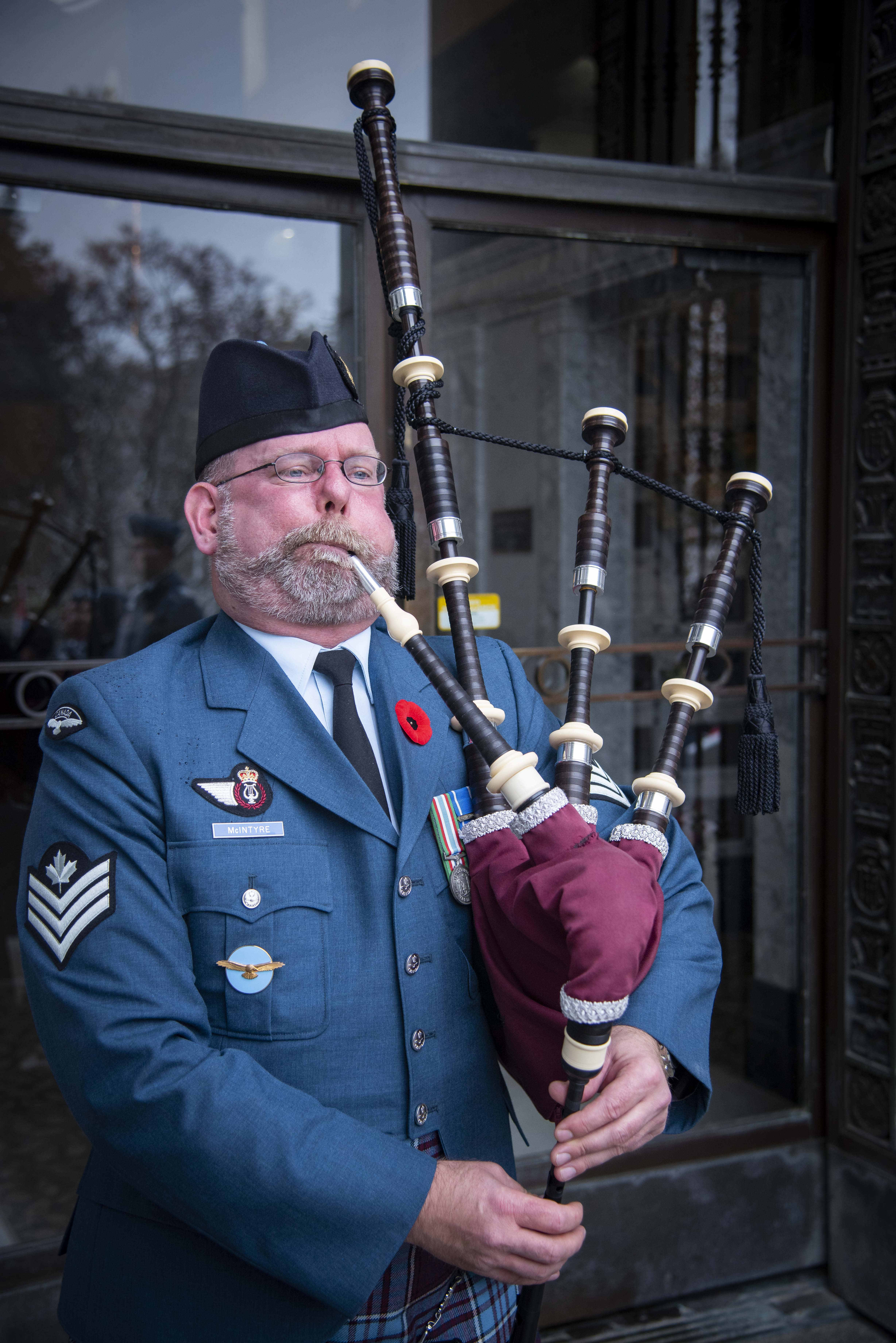 "Sergeant Kevin McIntyre of 16 Wing Borden, Ontario, plays the Lament (""Flowers of the Forest"") during the 2019 Remembrance Day ceremony held at the mausoleum where Wing Commander William Barker, VC, is interred in Mount Pleasant Cemetery, Toronto. PHOTO: Corporal Lynette Ai Dang, BM10-2019-0359-027"
