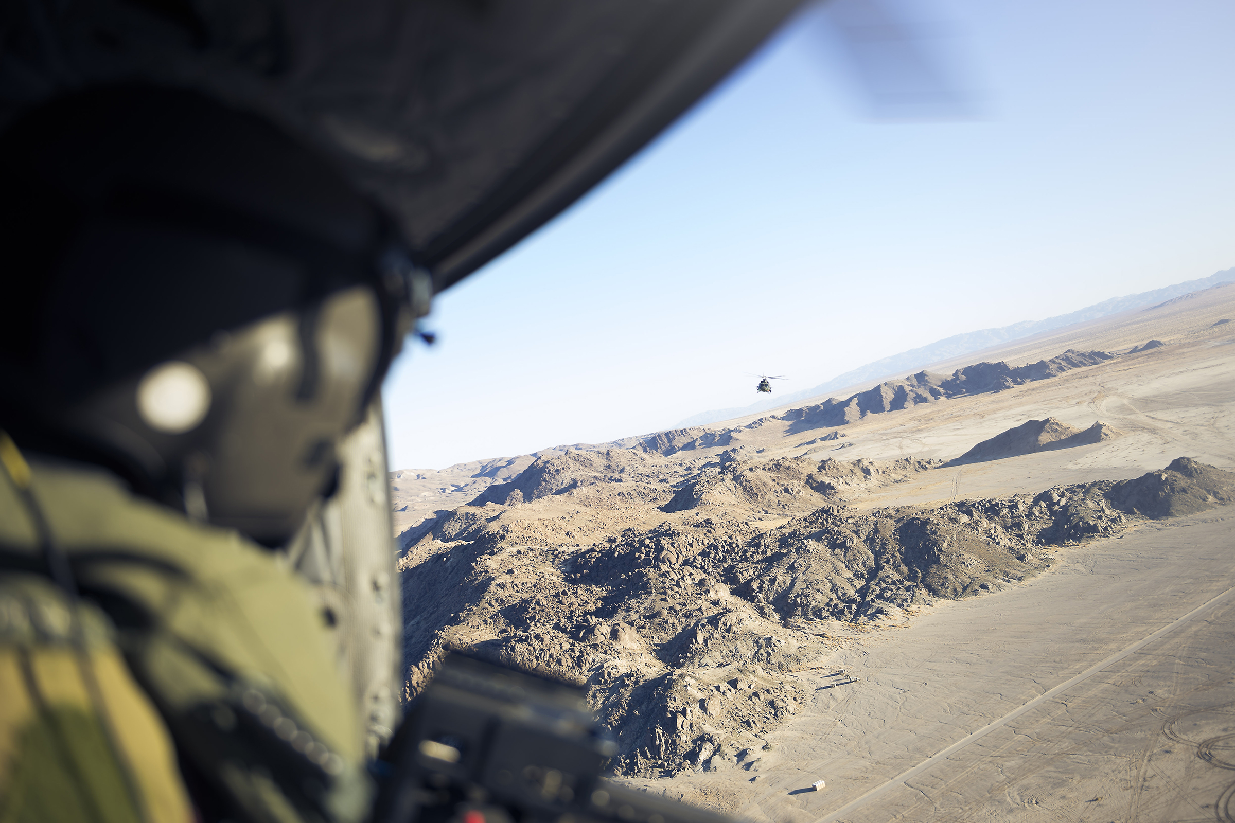 Members of 408 Tactical Helicopter Squadron conduct tactical flying training with CH-146 Griffon helicopters on November 11, 2019, during Exercise Striking Bat at Marine Corps Air Ground Combat Centrer Twentynine Palms, California. The squadron is practicing flying operations and helicopter maintenance in an austere and challenging desert environment, similar to what they will face during their upcoming deployment to Iraq. PHOTO: Corporal Desiree T. Bourdon, FA01-2019-0040-026