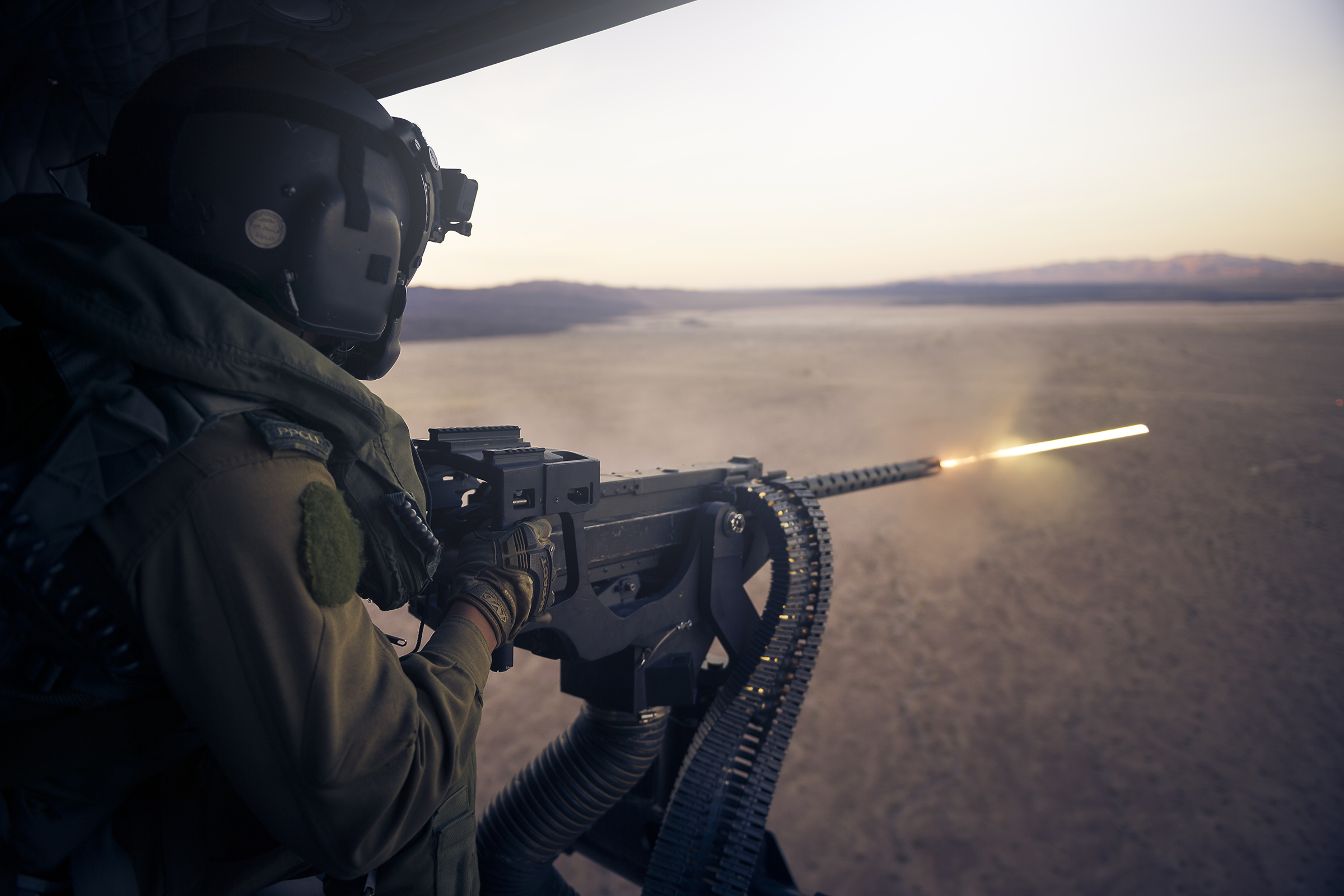 A 408 Squadron door gunner from Princess Patricia's Canadian Light Infantry fires a GAU-21 .50 caliber machine gun from the door of an RCAF CH-146 Griffon helicopter on November 11, 2019, during an exercise at Marine Corps Air Ground Combat Center Twentynine Palms, California. PHOTO: Corporal Desiree T. Bourdon, FA01-2019-0040-031