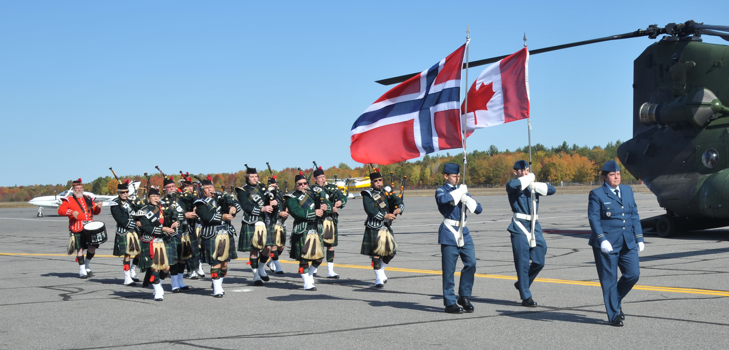 On October 11, 2019, the Bracebridge Pipes and Drums accompany the Norwegian and Canadian delegations in front of the terminal to greet local politicians as part of the 75th anniversary of the Royal Norwegian Air Force. PHOTO: Lieutenant Nora Amrane