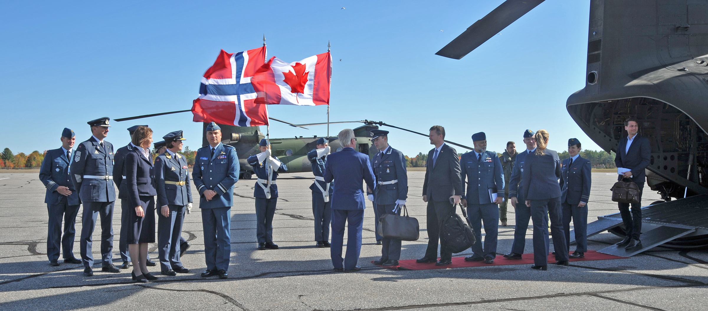 On October 11, 2019, Norwegian consul general Marianne Kortzinsky and Muskoka District vice-chair John W. Klinck welcome the head of the Norwegian Air Force and the deputy commander of the RCAF, Major-General Blaise Frawley, as well as other RCAF military personnel to Muskoka Airport to celebrate the 75th anniversary of the Royal Norwegian Air Force. PHOTO: Lieutenant Nora Amrane