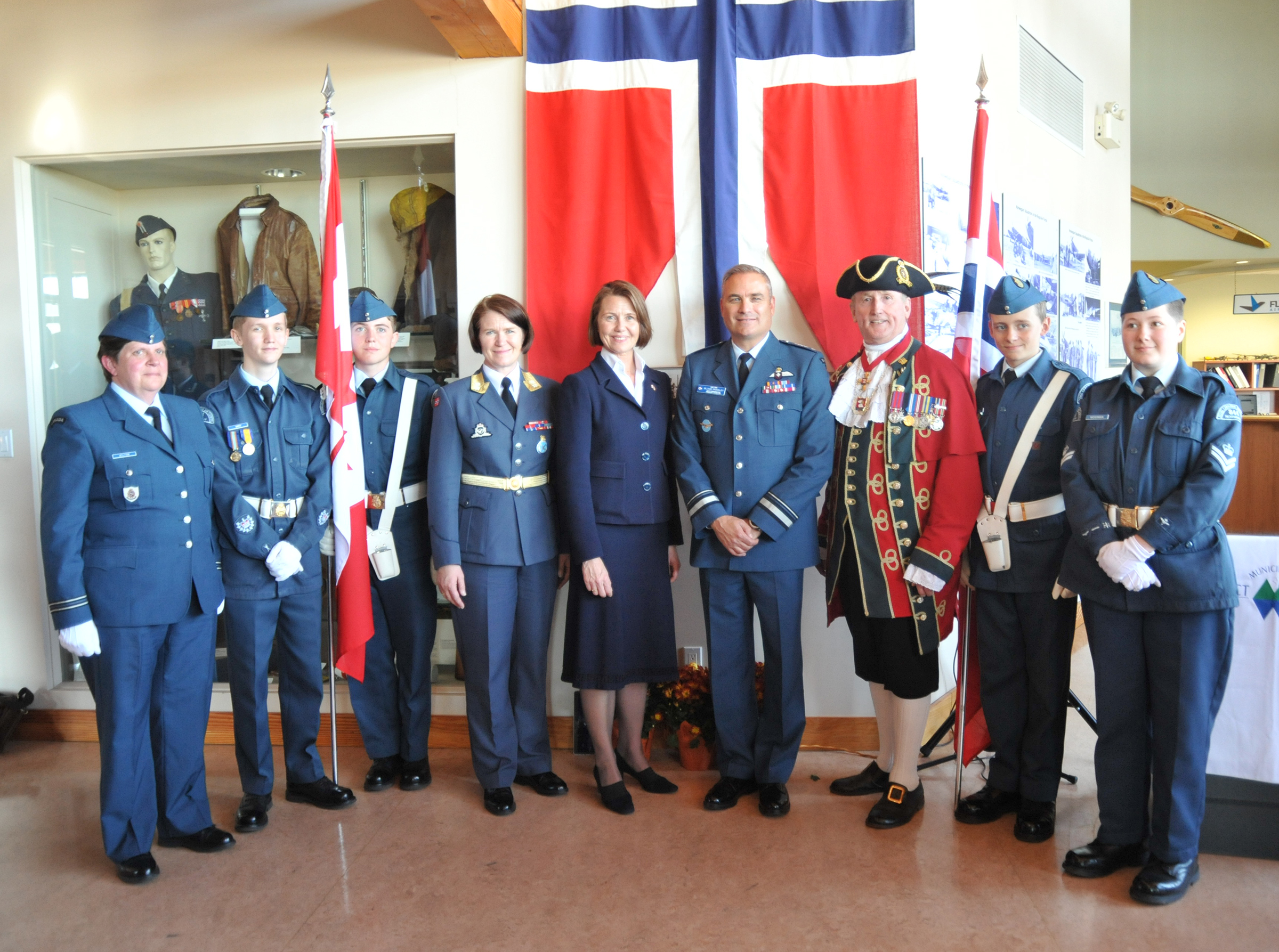 On October 11, 2019, (from left) Captain Patricia Wilton; Warrant Officer Second Class Harper Smith and Flight Sergeant Derek Rawn (bothmembers of the Royal Canadian Air Cadets); Major-General Tonje Skinnarland, chief of the Royal Norwegian Air Force; Norwegian ambassador Anne Kari H. Ovind; Major-General Blaise Frawley, deputy commander of the RCAF; town crier Bruce Kruger; as well as cadet Sergeant Carson Turney and cadet Flight Corporal Julia Mossman gather during a reception at Muskoka Airport to celebrate the Royal Norwegian Air Force's 75th anniversary. Attendees included. PHOTO: Lieutenant Nora Amrane