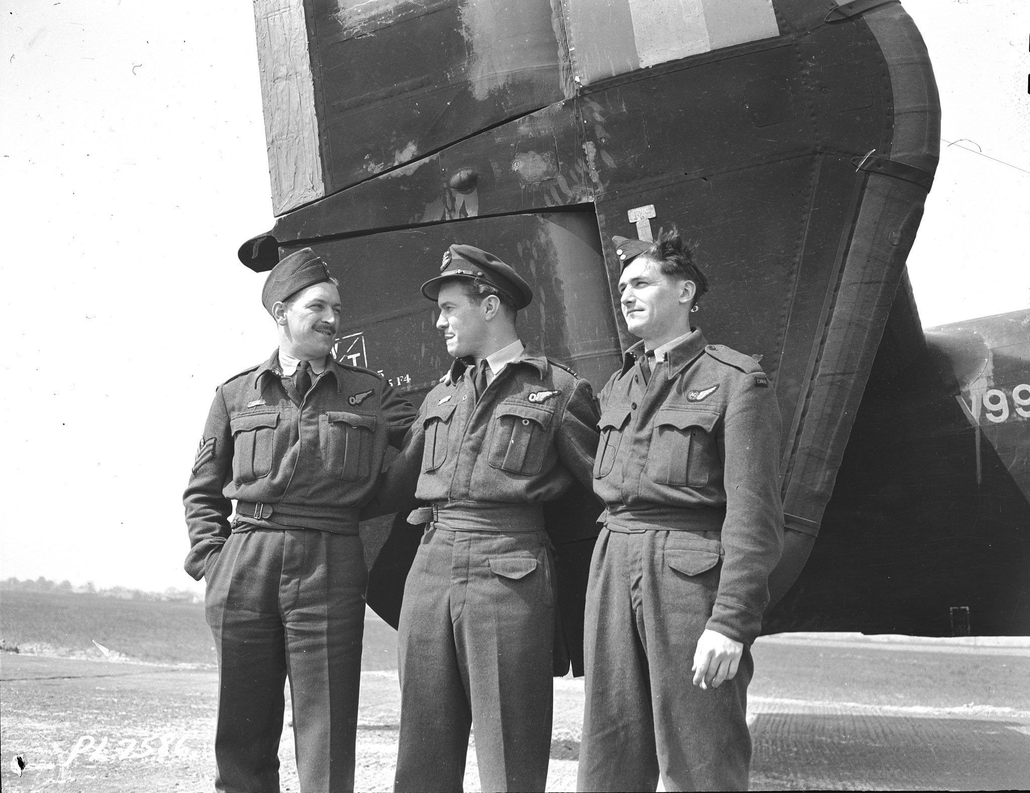 "Flight Lieutenant Jack Watts (centre) with two other members of No. 10 Squadron, which flew Halifax bombers: Flight Sergeant N.H. ""Newt"" Turner (left) and Flight Sergeant C.J. Hayes, on May 6, 1941. PHOTO: DND Archives, PL-7586"