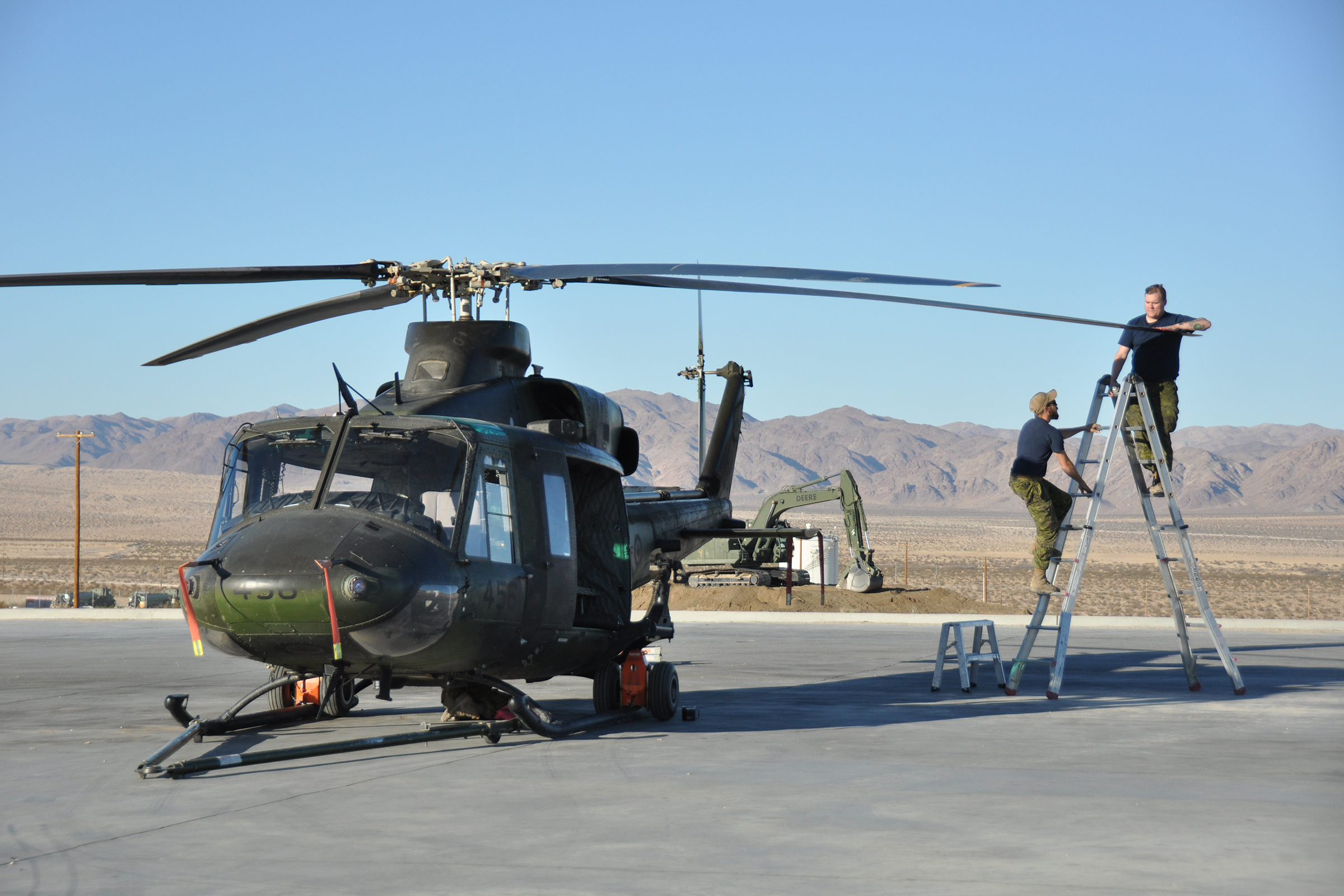 Maintainers from 408 Tactical Helicopter Squadron carry out maintenance on one of the squadron's CH-146 Griffons during Exercise Striking Bat at Marine Corps Air Ground Combat Center Twentynine Palms, California. The center is in the Mojave Desert. PHOTO: Corporal Desiree T. Bourdon, DND