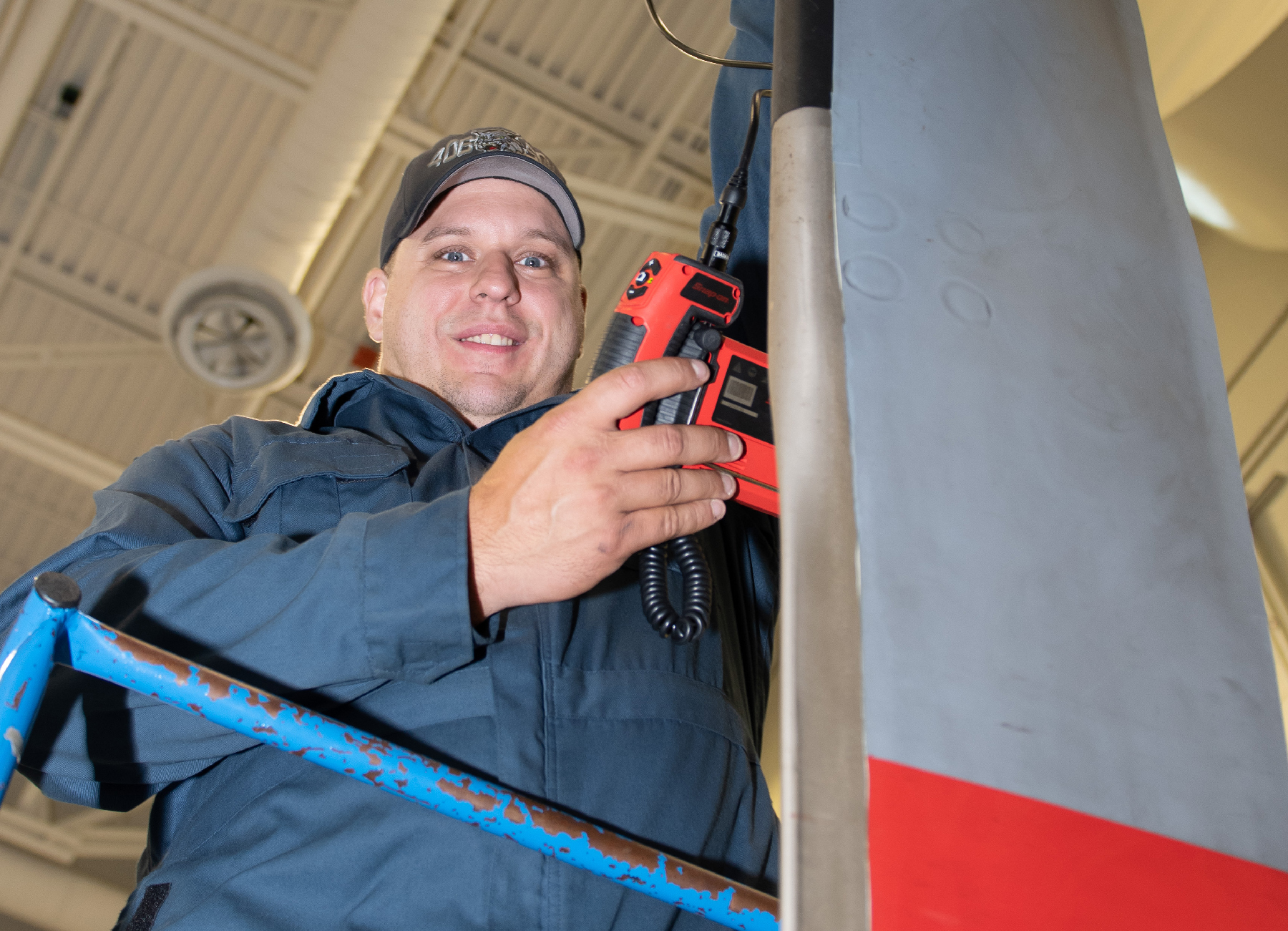 On October 2, 2019, 406 Squadron aviation systems technician Master Corporal Gabriel Auclair inspects components of the tail rotor on a CH-148 Cyclone Helicopter. PHOTO: Leading Seaman Laurance Clarke, SW05-2019-0447-003-