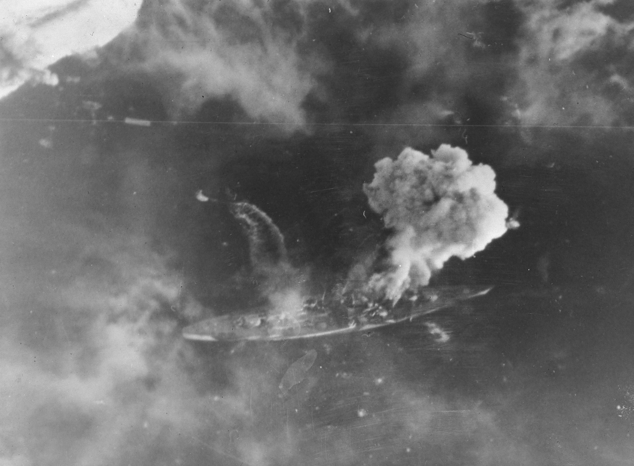 The German battleship Tirpitz under attack; Flight Lieutenant Watts was navigator on a Halifax bomber from 10 Squadron that participated in the attack. PHOTO: DND Archives, X-228