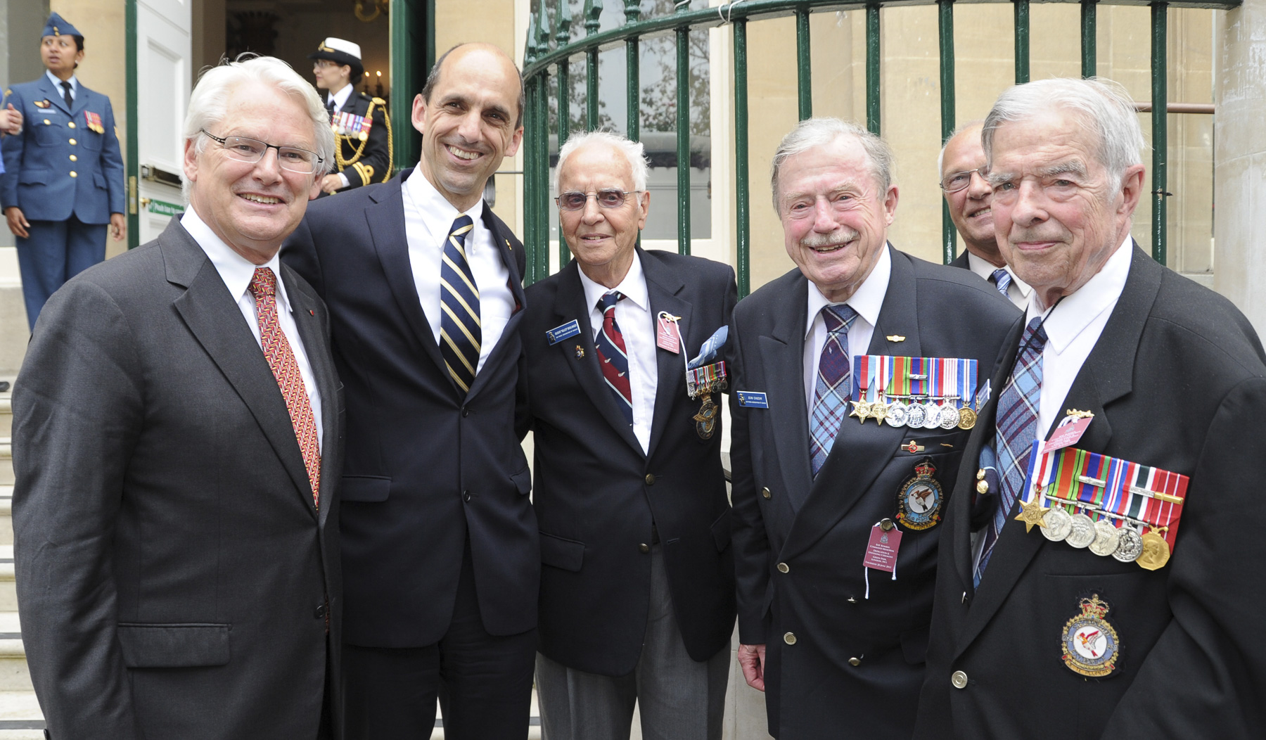 "On June 28, 2012, Canadian High Commissioner to the United Kingdom of Great Britain and Northern Ireland Gordon Muir Campbell (left) and Minister of Veterans Affairs Steven Blaney pose with three members of the war-era 425 Squadron (the ""Allouettes), Mr. Gilbert ""Gilles"" Boulanger, Mr. Jean Cauchy and Mr. François Savard, following the dedication of the Bomber Command Memorial in London, England. PHOTO: Sergeant Alain Martineau, FA2012-1037-007"