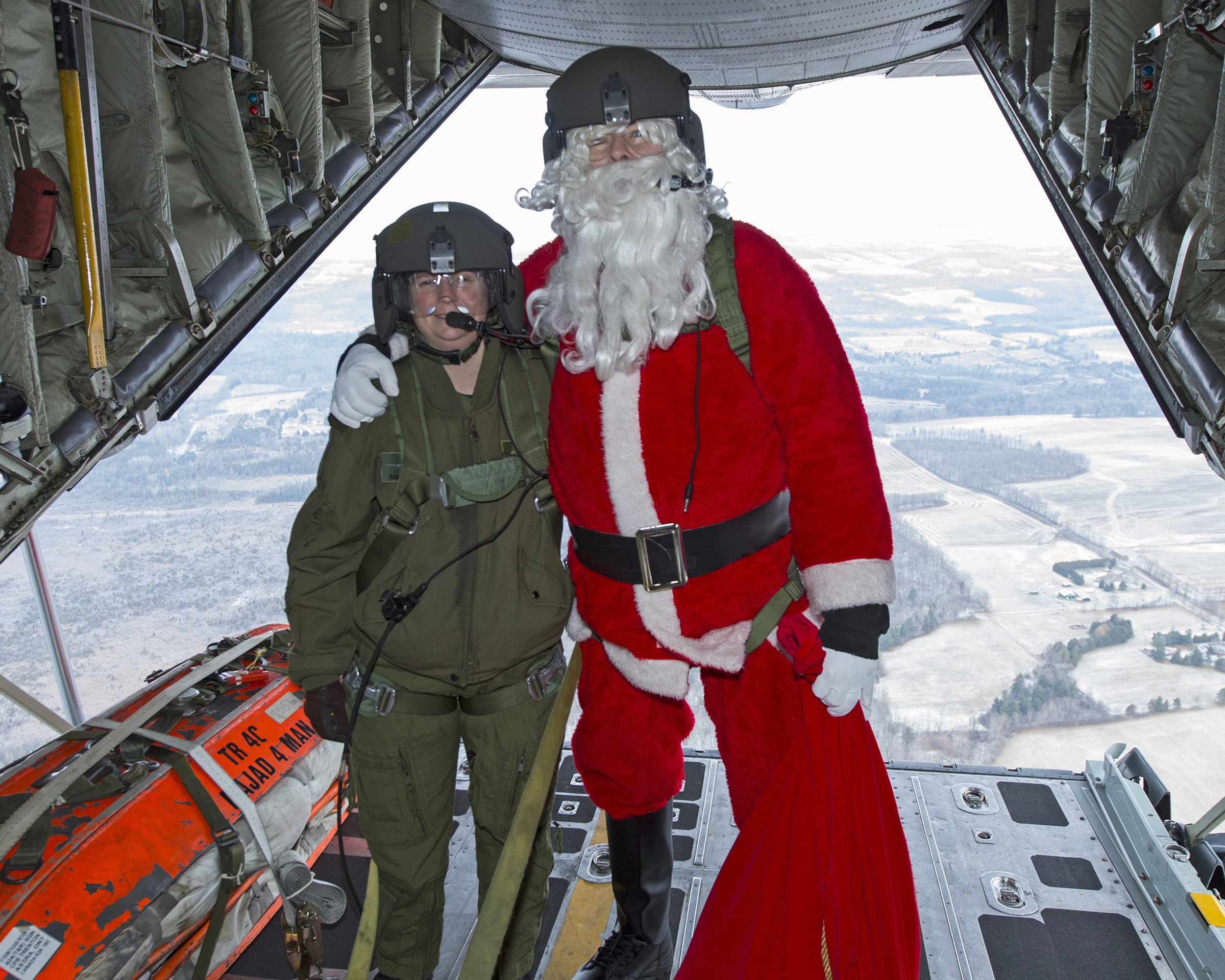 Santa and his newest BFF (Best Flying Friend) loadmaster Corporal Sandy Bridger on the open ramp of a CC-130H Hercules from 424 Transport and Rescue Squadron on December 5, 2018, during Santa's familiarization flight. PHOTO: Leading Seaman Dan Bard, TN09-2018-0441-087