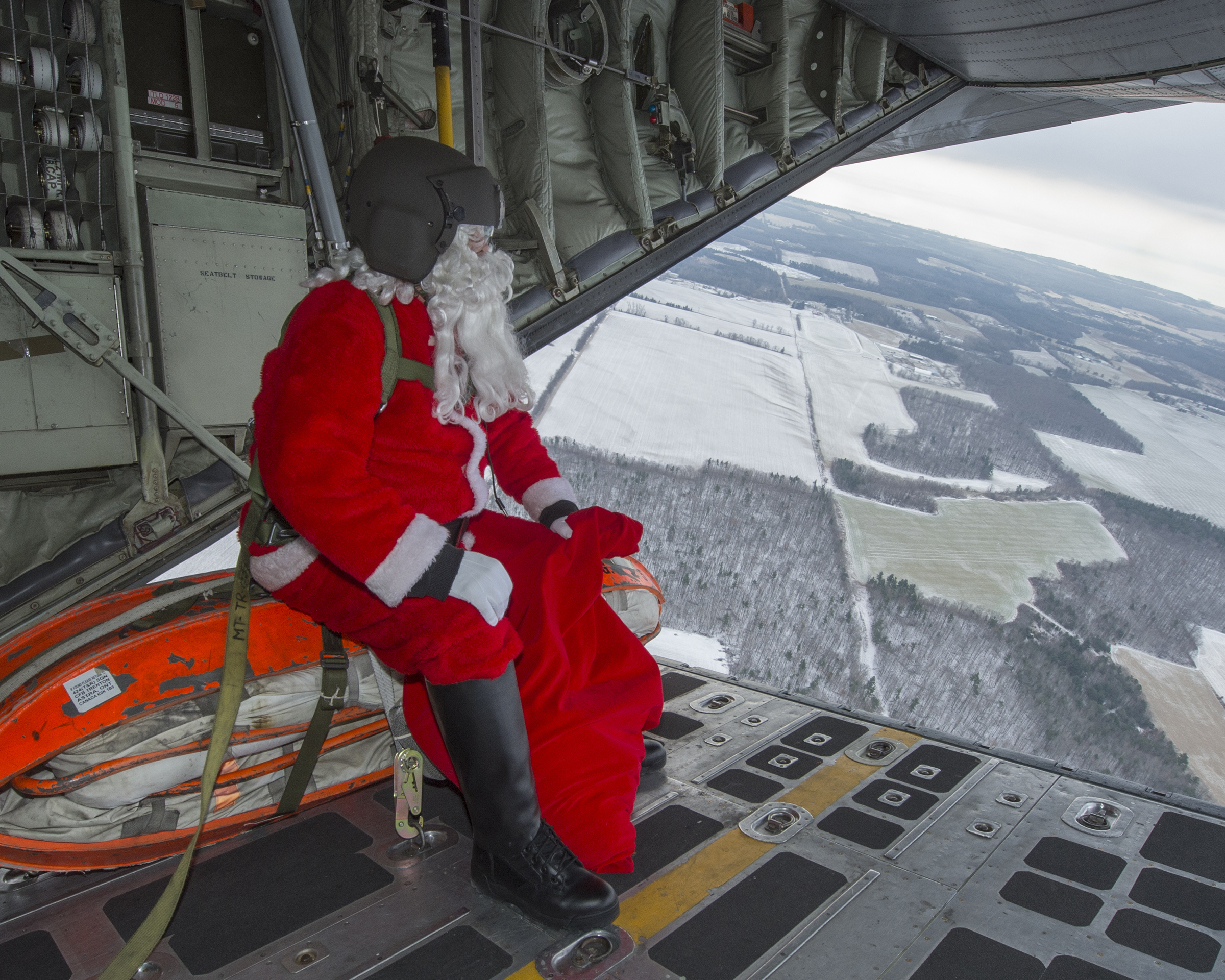 Santa sits on the open ramp of a CC-130H Hercules aircraft from 424 Transport and Rescue Squadron, thinking all the children he will visit in the Quinte area on the evening of December 24. PHOTO: Leading Seaman Dan Bard, TN09-2018-0441-099