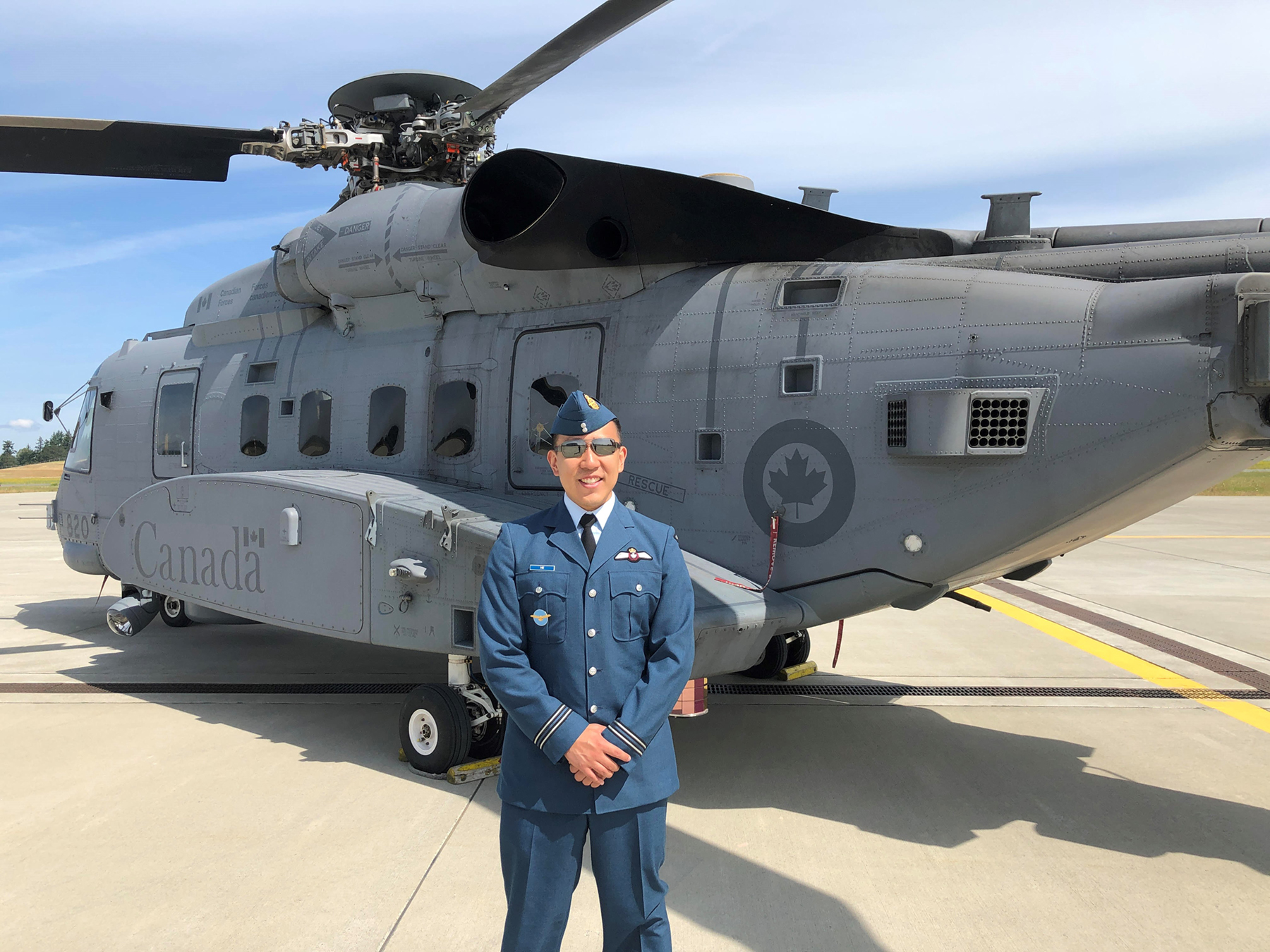 Captain David He stands with one of the RCAF's new CH-148 Cyclone helicopters. PHOTO: Submitted