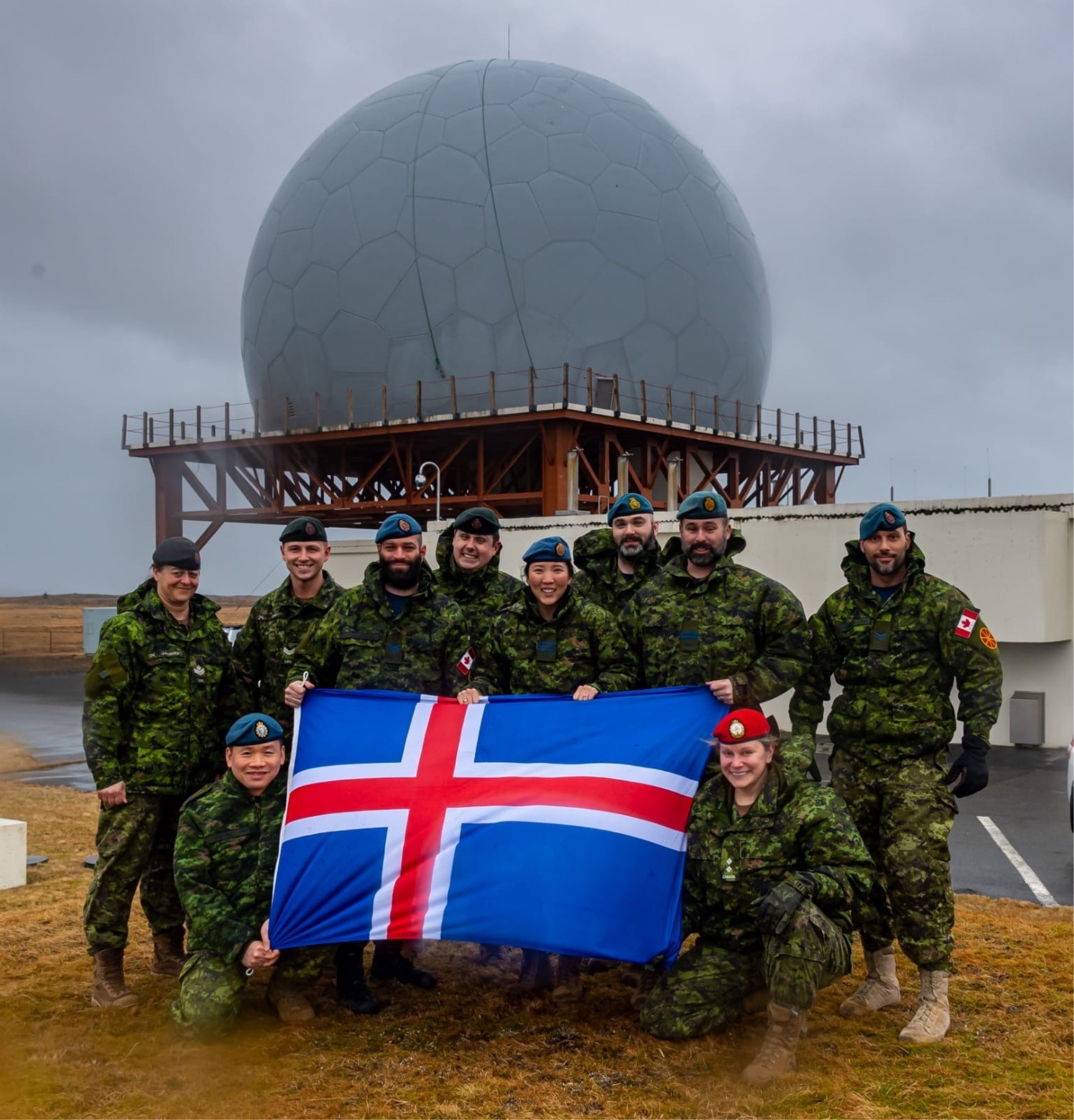 Major Jane Yoon (standing, fourth from the right) shown with the team from 2 Wing during her deployment as the Airfield Activation and Surge Team Commander on Operation Illumination in Iceland in January 2020. PHOTO: Submitted