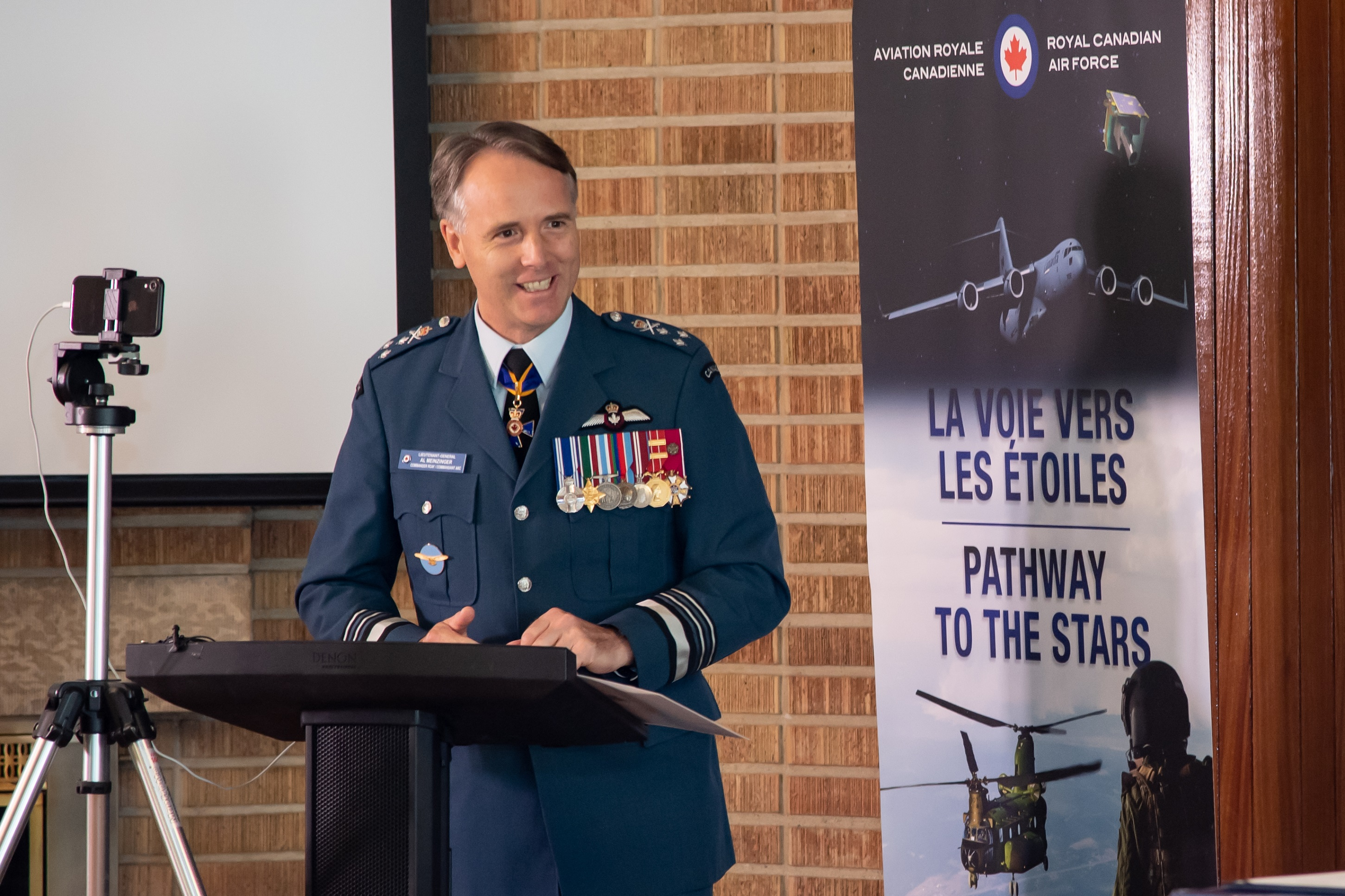 Reviewing Officer, Lieutenant-General Meinzinger, Commander Royal Canadian Air Force, addresses parade spectators and virtual attendees during the 1 Canadian Air Division change of command ceremony, July 6, 2020. PHOTO: Corporal Darryl Hepner