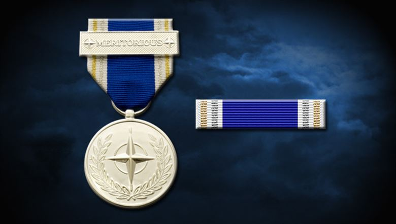 The NATO Meritorious Service Medal (MSM) was first awarded in 2003 to commend NATO staff whose personal initiative and dedication went beyond their duty to make a difference both to their colleagues, and to NATO as an organization. The Medal is the personal award of the Secretary General of NATO, who signs each citation. Fewer than 50 medals are awarded each year and it remains the only significant award for individual personal effort for NATO staff. When assessing nominations for the award, there are several criteria taken into consideration: the performance of acts of courage in difficult or dangerous circumstances; showing exceptional leadership or personal example; making an outstanding individual contribution to a NATO sponsored program or activity; or enduring particular hardship or deprivation in the interest of NATO. IMAGE: NATO