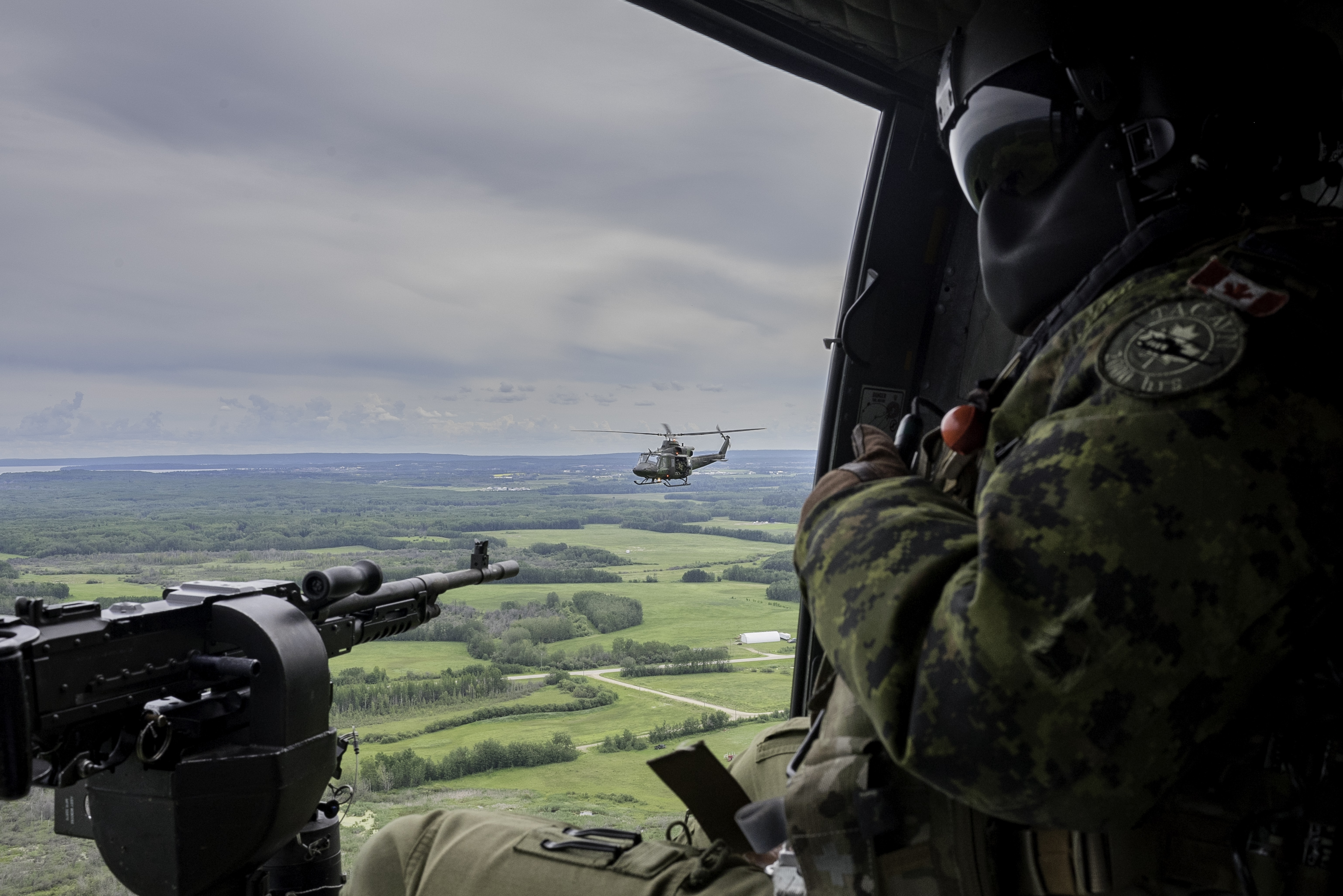 Royal Canadian Air Force CH-146 Griffons from 408 Tactical Helicopter Squadron participate in exercise Gander Gunner near 4 Wing Cold Lake, Alberta, on July 21, 2020. PHOTO: Private Connie Valin