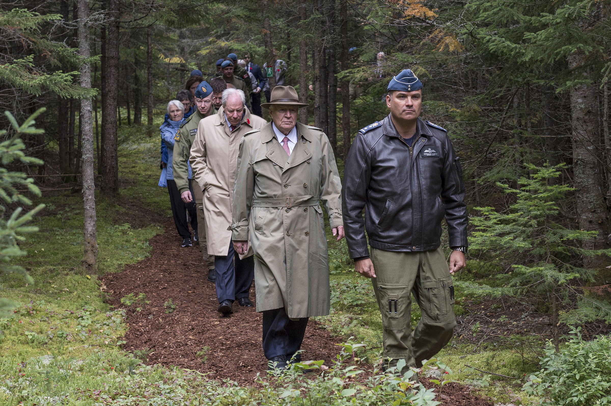 On September 14, 2019, Major-General Blaise Frawley, deputy commander of the Royal Canadian Air Force, leads the way to the crash site, followed by Mr. J.K. Irving and Mr. Jim Irving, both of of J.D Irving, Limited, and other guests for the unveiling of a memorial commemorating Warrant Officer Class 2 James Edward Doan and Corporal David Alexander Rennie who were the first members of the RCAF to die on Canadian soil during the Second World War. PHOTO: Corporal Nicolas Alonso, GN02-2019-0949-007