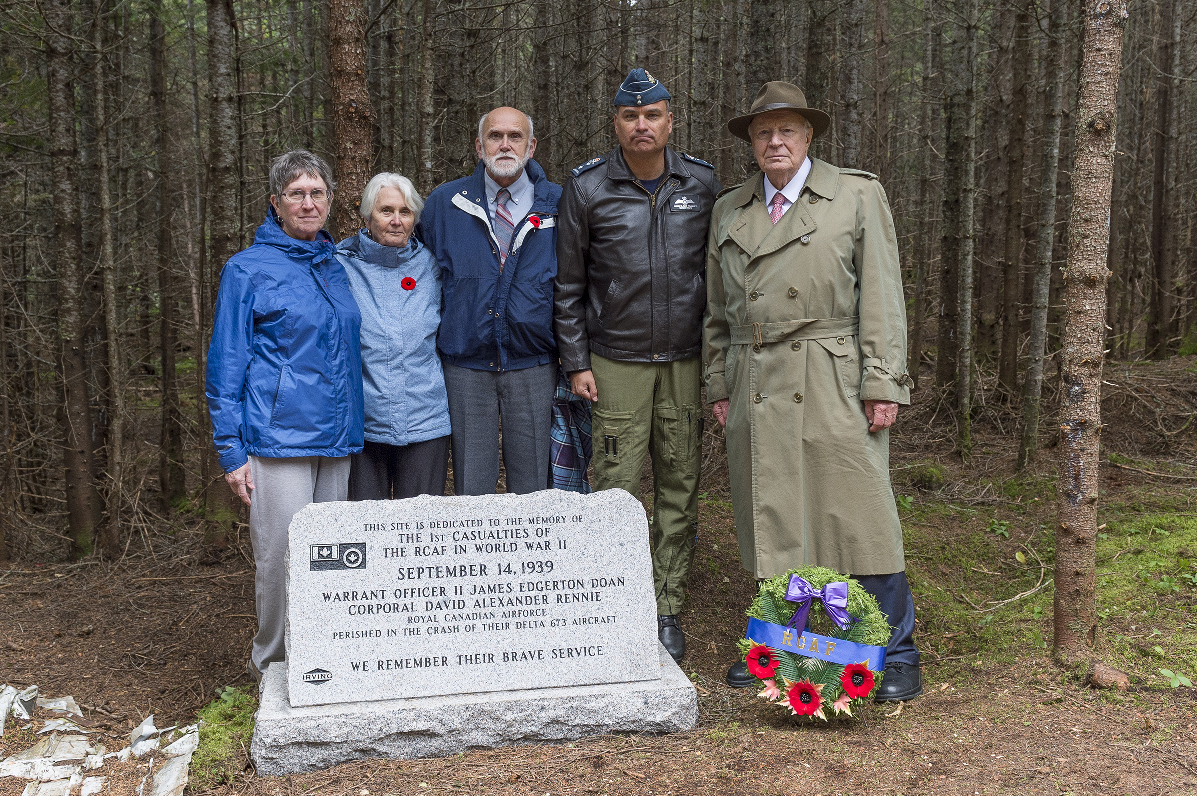 On September 14, 2019, (from left) Walter Bateson, Lynda Diepold, Shirley Routliffe, Major-General Blaise Frawley and Mr. J.K. Irving stand behind the new monument commemorating Warrant Officer Class 2 James Edward Doan and Corporal David Alexander Rennie who died on September 14, 1939, when their Northrop Delta aircraft crashed near Plaster Rock, New Brunswick. PHOTO: Corporal Nicolas Alonso, GN02-2019-0949-019