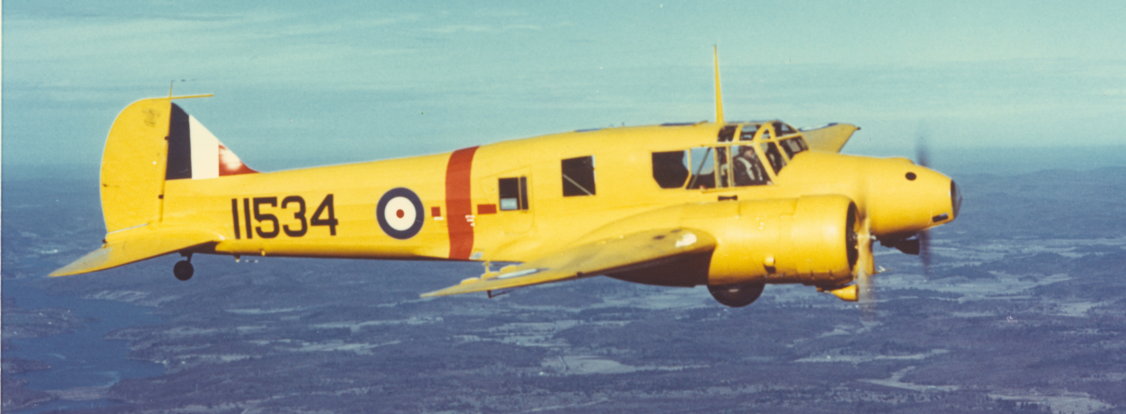 An early model Royal Canadian Air Force Anson as used in the British Commonwealth Air Training Plan. The yellow overall finish, which denoted training aircraft, was typical of many BCATP aircraft. PHOTO: Courtesy T.F.J. Leversedge
