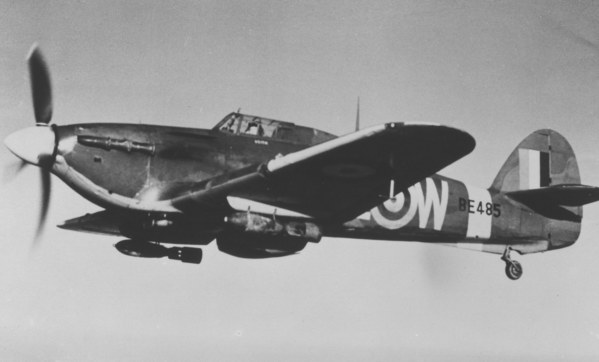 A Hawker Hurricane Mk IIB from 402 (Fighter) Squadron crosses the English Channel on an intruder sortie into occupied France in 1941. It carries 250 pound bombs slung under its wings PHOTO: DND Archives, PL-6897
