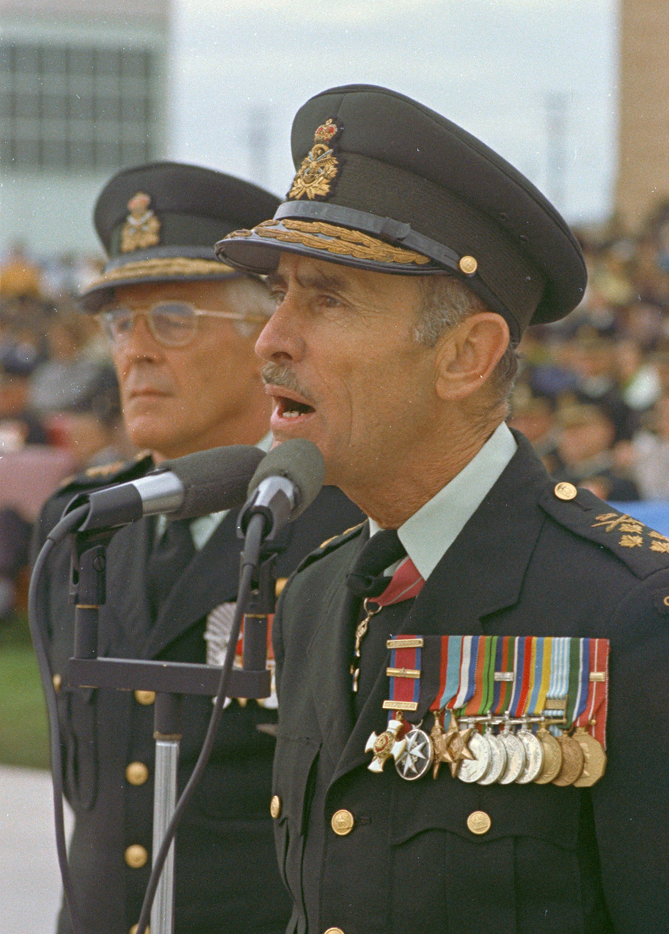 "Chief of the Defence Staff General J. A. Dextraze, right, speaks during ceremonies marking the establishment of Air Command in 1975. Lieutenant-General Bill Carr, who became known as the ""father of Air Command"" stands beside him. PHOTO: DND Archives, IEC75-144"
