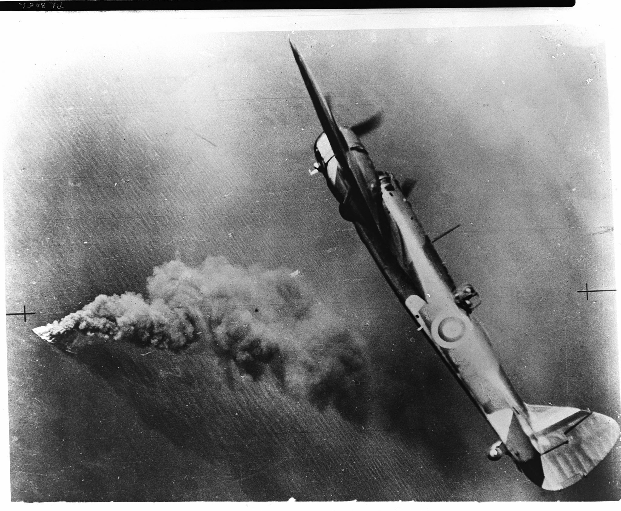 A Royal Air Force Bristol Blenheim bomber watches the end of an enemy tanker as, ablaze from stem to stern, she sinks in the Channel off the French coast. PHOTO: RAF