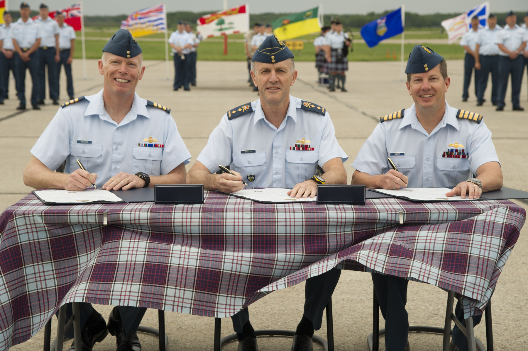 On June 30, 2015, Lieutenant-Colonel Joseph Mullins (left), Commanding Officer of 401 Tactical Fighter Squadron; Major-General David Wheeler, 1 Canadian Air Division Commander; and Colonel Eric Kenny, Wing Commander of 4 Wing, sign the stand-up scrolls for 401 Tactical Fighter Squadron.