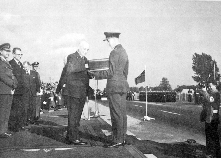 The Prime Minister of Canada, Louis St. Laurent, accepts the keys to the BCATP Memorial Gates on behalf of the Government of Canada and places them in a special case. The presentation of the gates took place during a ceremony held September 30, 1949, at RCAF Station Trenton, Ontario. PHOTO: From the presentation ceremony commemorative booklet