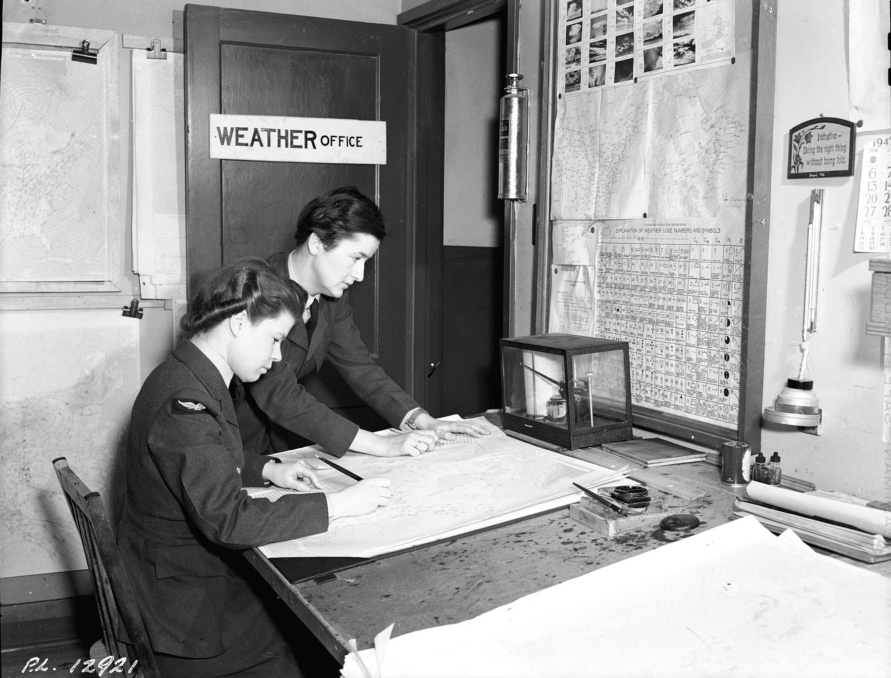 Trained at the University of Toronto, Ontario, Royal Canadian Air Force meteorological observers such as these airwomen at No. 9 Bombing and Gunnery School on RCAF Station Mont-Joli, Québec, worked in the weather control towers on many stations, usually on around-the-clock shifts. PHOTO: DND Archives, PL-12922