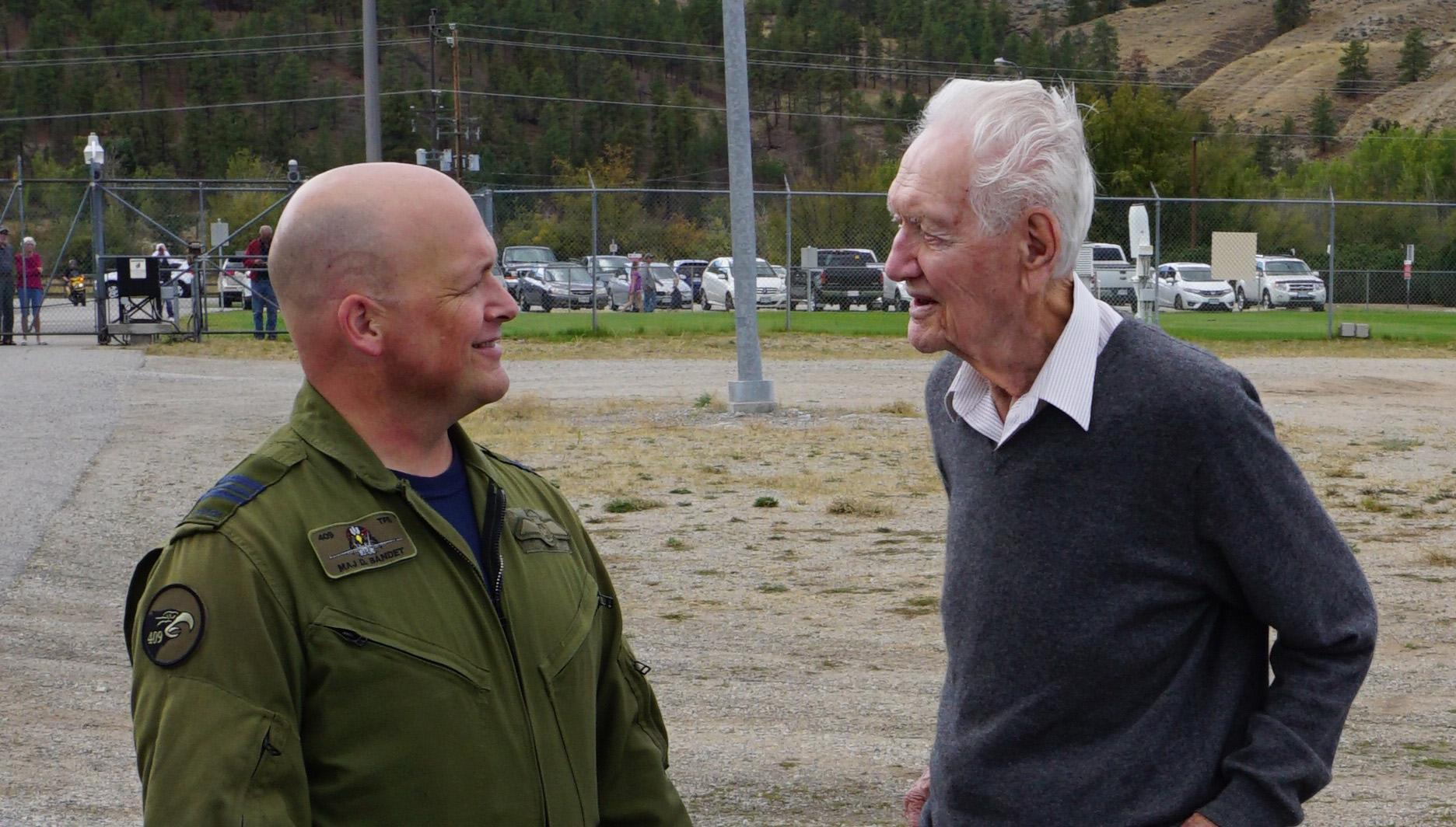 Major Denis Bandet, the deputy commanding officer of 409 Tactical Fighter Squadron, chats with Squadron Leader (retired) John Hart, Canada's last known surviving Battle of Britain pilot, at the Penticton Regional Airport in British Columbia. PHOTO: Submitted