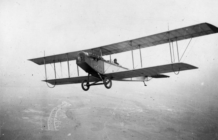 "The Royal Flying Corps selected the Curtiss JN 3 ""Jenny"" two-seater biplane as the training aircraft of choice. The type was then manufactured in Canada under license by Canadian Aeroplanes Limited, and the Canadian version was given the designation JN 4 ""Canuck"". This photo shows a Curtiss JN-4 in flight over Camp Borden, Ontario. PHOTO: LAC MIKAN 3390046"