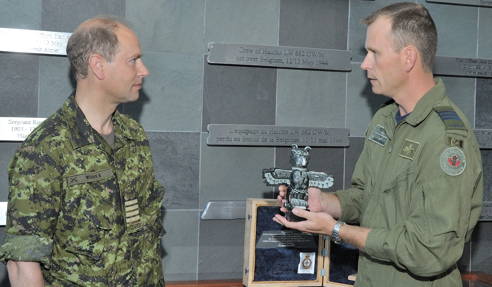 "Lieutenant-Colonel Damon Perrault, commanding officer of 426 Squadron, presents a gift, symbolizing 426 ""Thunderbird"" Squadron, to Prince Edward. PHOTO: Corporal Levarre McDonald, TN2012-0422-03"