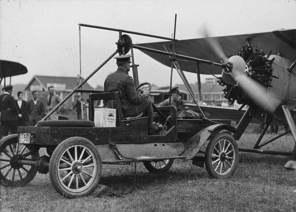 A starter car is used to boot the motor of an RCAF Siskin biplane fighter aircraft at Leaside flying field in Toronto in 1929. That same year, a three-plane Siskin air demonstration team—the RCAF's first official flight demonstration team—was formed at Camp Borden, Ontario, just north of Toronto. The aerobatic team put on popular solo and formation displays, first over appreciative audiences in Toronto and then from coast to coast. The Siskin was retired from all use except as a first-stage trainer at the onset of the Second World War. PHOTO: City of Toronto Archives, Fonds 1244, Item 4521
