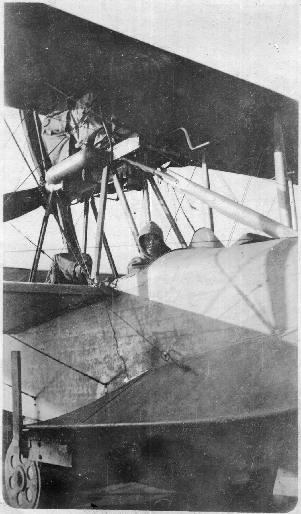 At the end of the First World War, a person sits in the cockpit of a Curtiss HS-2L flying boat at Baker Point/U.S. Naval Air Station Halifax, Nova Scotia. PHOTO: Shearwater Aviation Museum / https://hmhps.ca/sites/bakers-point-or-12-wing-shearwater (Halifax Military Heritage Preservation Society)