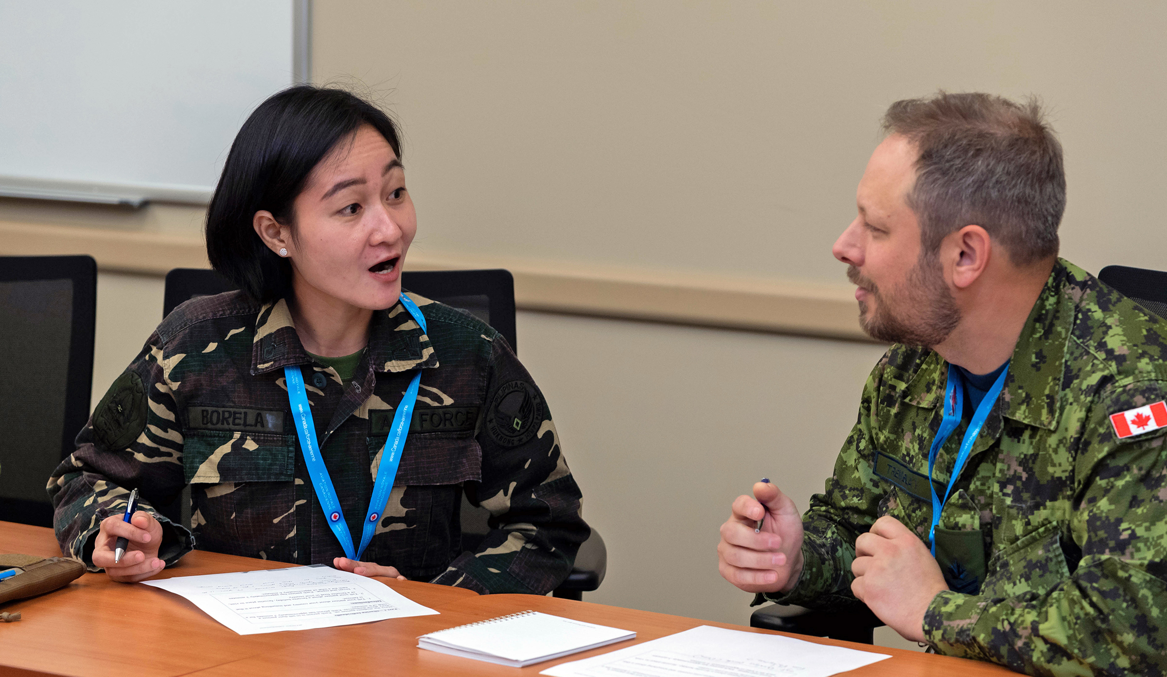 A member of the Philippine Air Force (left) and a member of the Royal Canadian Air Force discuss an issue during the Junior Enlisted Leadership Forum held at 17 Wing Winnipeg, Manitoba, from October 21 to 25, 2019. PHOTO: Corporal Brian Lindgren, WG2019-0525-006