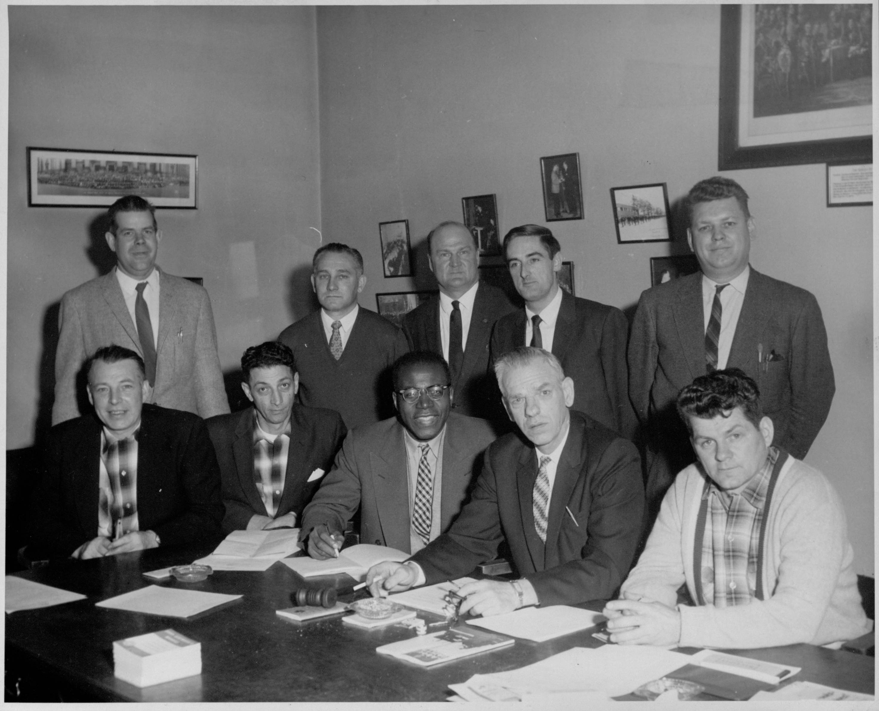 Henry Langdon and the executive committee of the International Association of Machinists Lodge 1751 in 1960. The Union became the International Association of Machinists and Aerospace Workers in 1965. Standing, left to right, are Tim Horst; L. Brosseur; B.T. Horan, general chairman of the l lodge; Mike Pitchford, shop chairman; and E. Davidson, financial secretary. Seated, left to right, are J. Comeau, trustee; R. Galazzo, trustee; Henry Langdon, recording secretary; Victor Rugenius, president; and E.D. Bowles, treasurer. PHOTO: L1985-13_018_019_029, International Association of Machinists and Aerospace Workers Photograph Collection, Southern Labor Archives. Special Collections and Archives, Georgia State University