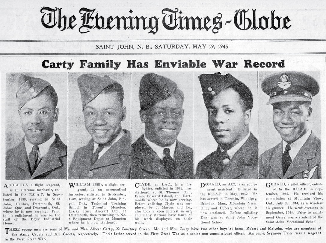 "A news clipping with the headline ""Carty family has enviable war record"", showing head-and-shoulders photos of five men."