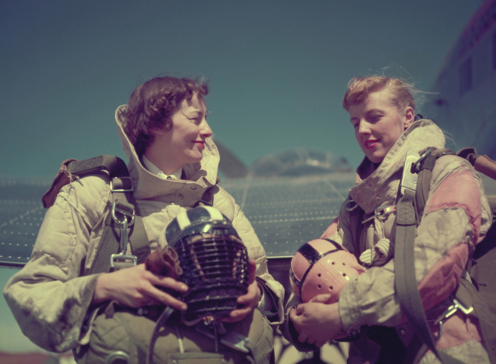 Flying Officer Marian Neilly (left) and Flying Officer Marion MacDonald, both Nursing Sisters, wear their para rescue jumping gear during Operation Pike's Peak at Lowry Air Force Base in Denver, Colorado, on March 24, 1955. The Joint USAF/RCAF exercise aided the two services' rescue units in adopting a system whereby both can participate in rescue missions in either country. PHOTO: DND Archives, PC-676