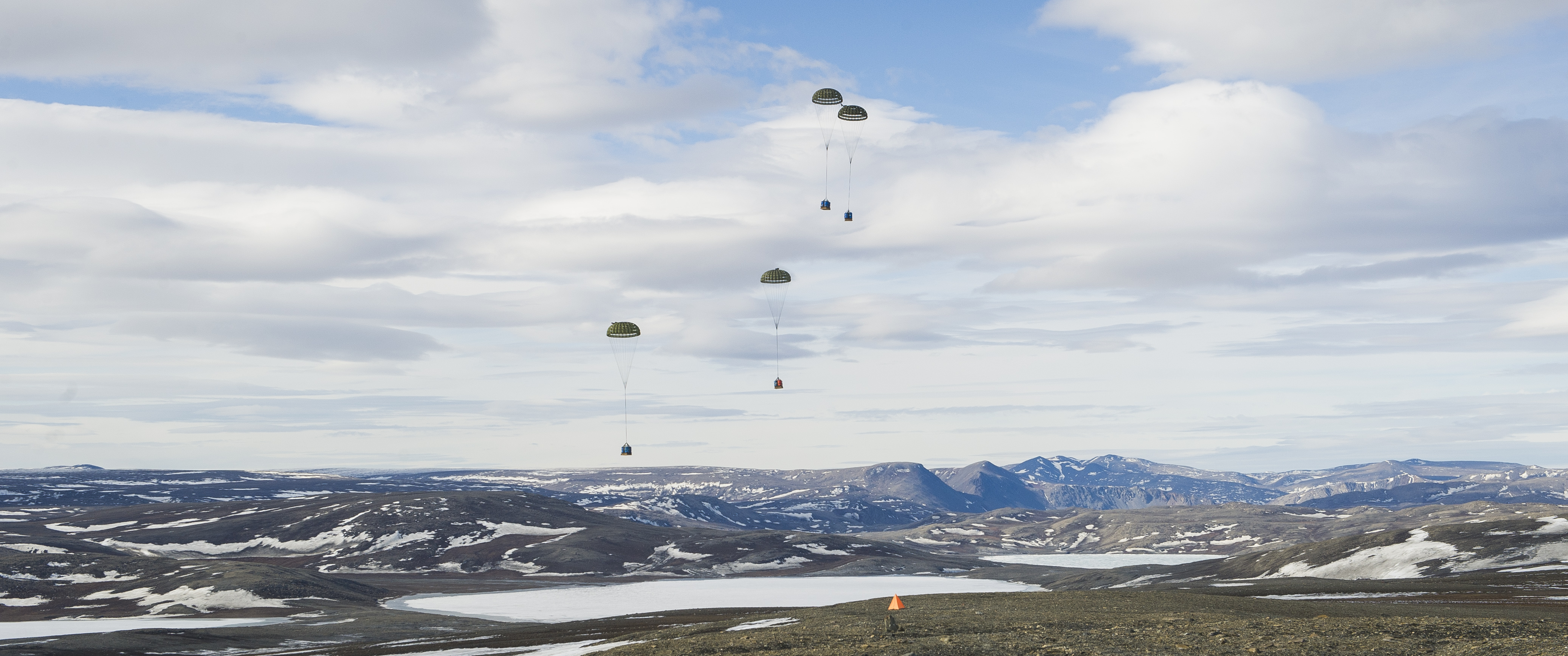 The airdrop at the northernmost habitation on Earth was conducted to validate the Royal Canadian Air Force's capability to sustain Canadian Forces Station Alert year-round, regardless of weather or other conditions, to support Canadian Armed Forces operations and presence in the North. PHOTO: Private Natasha Punt