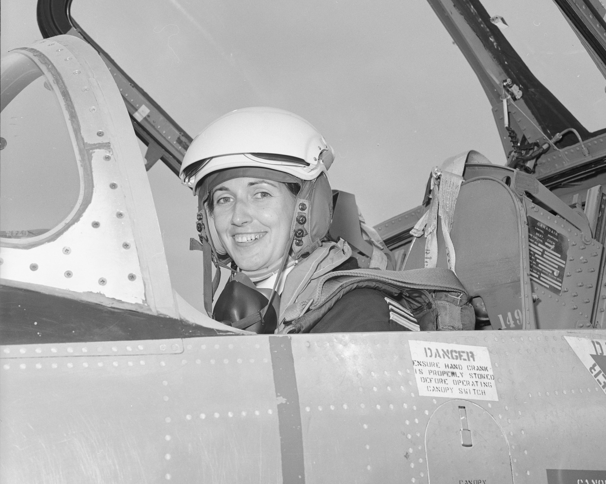 Major Wendy Clay, a flight surgeon with the Royal Canadian Air Force, earned her pilot's wings in 1974, six years before the occupation of pilot opened to women. She wanted to better understand the effects of flight on aircrew. In this photo, taken August 19, 1974, she sits in the cockpit of the CT-114 Tutor aircraft in which she took her final test to qualify for her wings at Moose Jaw, Saskatchewan. PHOTO: MJ74-1221, DND Archives