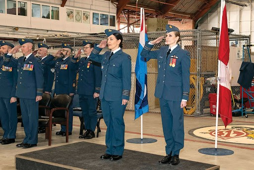 417 Combat Support Squadron (CSS) Commanding Officer, Major Alexia Hannam (right) and Incoming 417 CSS Honorary Colonel, Kendra Kincade salute for the National Anthem during the Honorary Colonel Investiture Ceremony held inside Hangar 6 on March 1, 2019 at 4 Wing, Cold Lake, Alberta. PHOTO: Sailor Second Class Erica Seymour