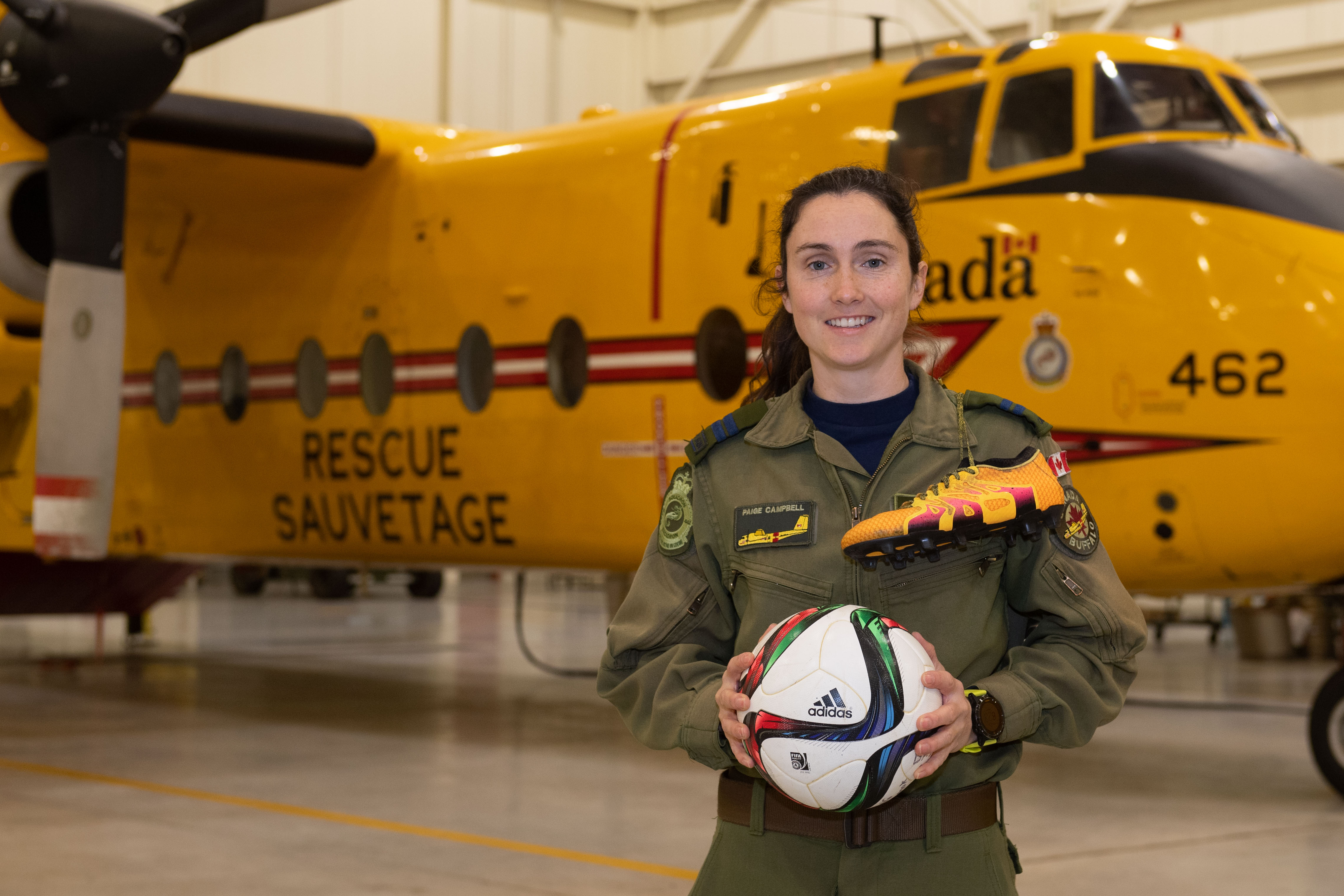 RCAF Female Athlete of the Year, Captain Paige Campbell, an Air Combat Systems Officer with 442 Transport and Rescue Squadron, at 19 Wing Comox, poses in front of a CC-115 Buffalo search and rescue aircraft at 19 Wing Comox, British Columbia, on December 3, 2020. PHOTO: Corporal Joey Beaudin